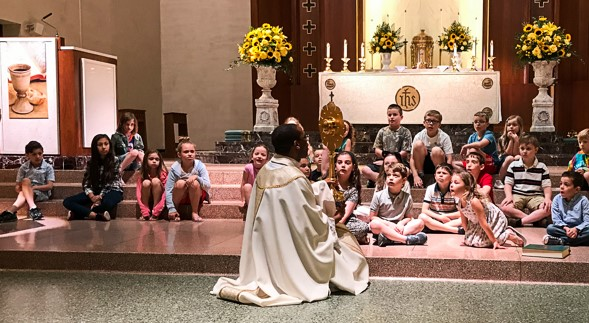 Fr. Fortunatus at Children's Mass